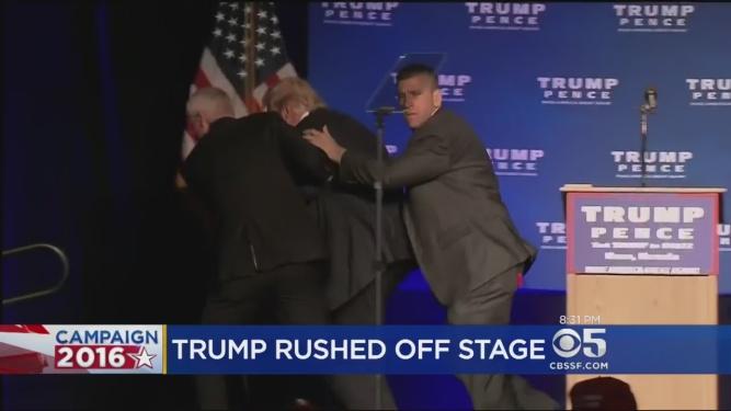 trump-rushed-away