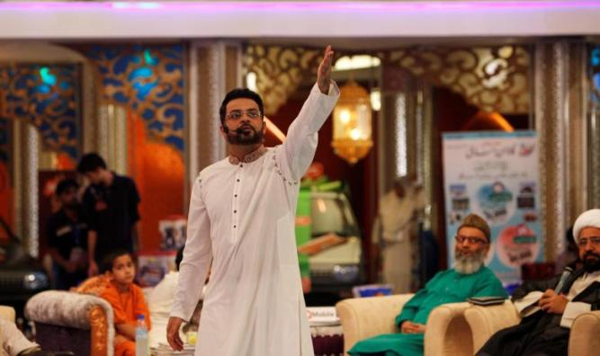 FILE PHOTO: Hussain recites religious rhyme during a live show in Karachi