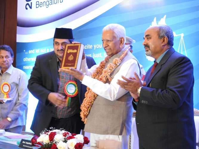 Honorable Governor gifted with Holy Quran by Mr. Shiraz Ahmad the Additional Executive Director of the Ahmadiyya Muslim Community