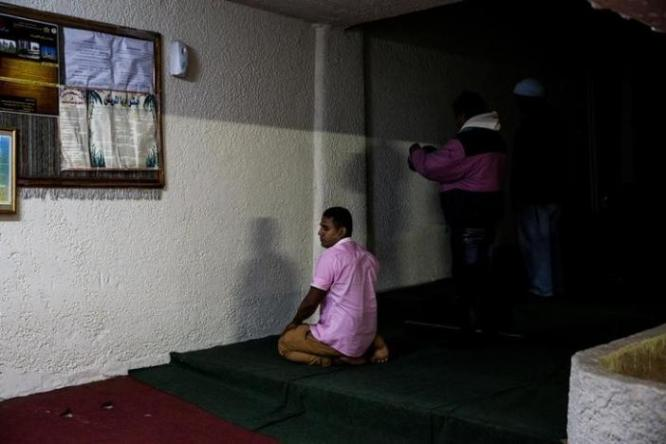 Muslims living in Greece pray at the Masjid Al-Salam makeshift mosque in Athens