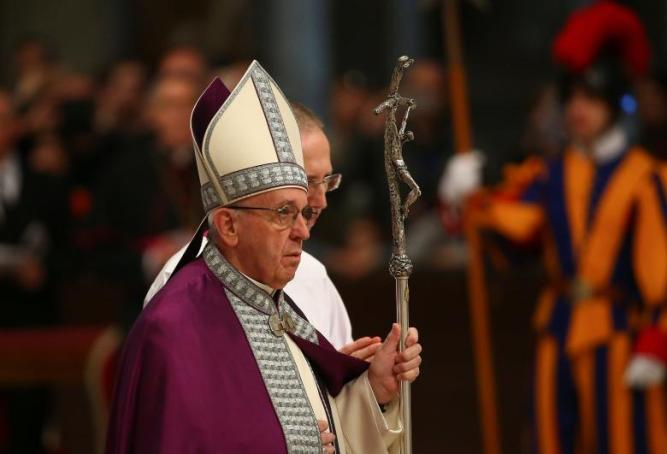 Pope Francis arrives during the penitential celebration in St. Peter's Basilica at the Vatican