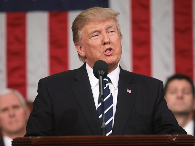 US President Donald J. Trump delivers his first address to a joint session of Congress from the floor of the House of Representatives in Washington