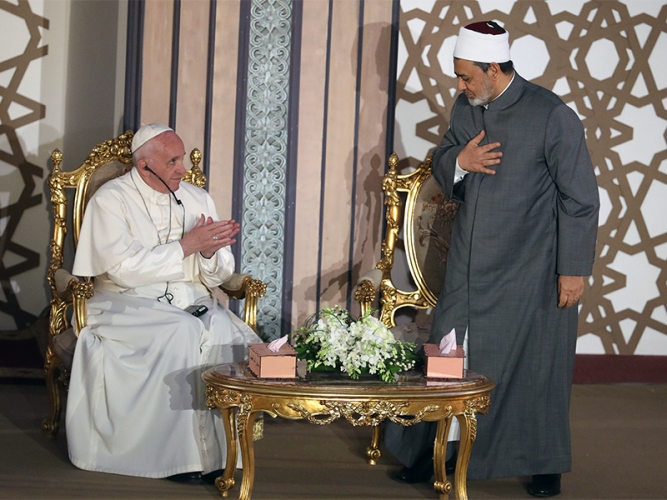 Pope Francis greets Al-Azhar's Grand Imam Ahmed al-Tayeb during a meeting at Cairo