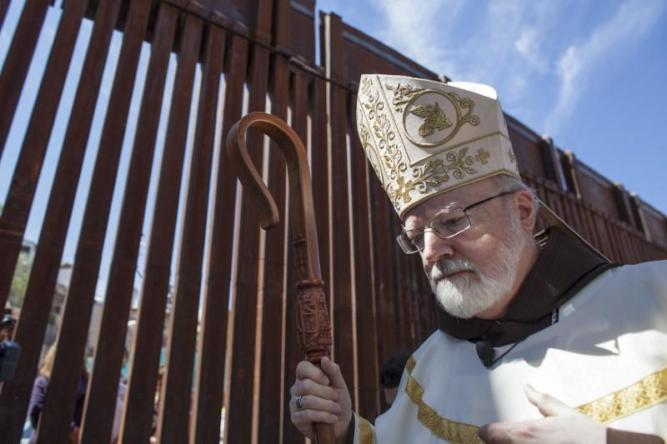 Cardinal Sean O'Malley of Boston leads a procession of bishops and other followers as they walk to celebrate a mass at the United States and Mexico border near Nogales