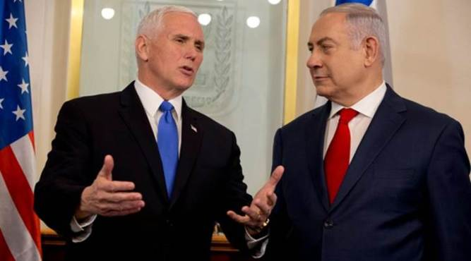U.S. Vice President Mike Pence speaks with Israeli Prime Minister Benjamin Netanyahu during a meeting at the Prime Minister's office in Jerusalem