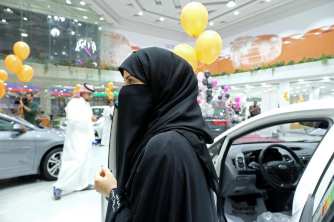A Saudi woman is seen at the first automotive showroom solely dedicated for women in Jeddah