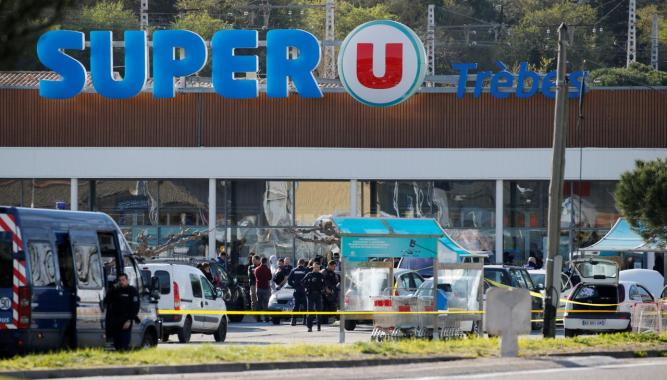 FILE PHOTO: A general view shows gendarmes and police officers at a supermarket after a hostage situation in Trebes