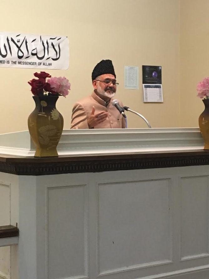 Ahmadiyya Muslim Missinary Imam Syed Shamshad A. Nasir speaking at the Interfaith Symposium