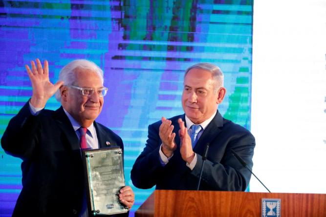 Israeli Prime Minister Benjamin Netanyahu claps after handing U.S. Ambassador to Israel David Friedman a letter of appreciation, during a reception held at the Israeli Ministry of Foreign Affairs in Jerusalem, ahead of the moving of the U.S. embassy to Jer