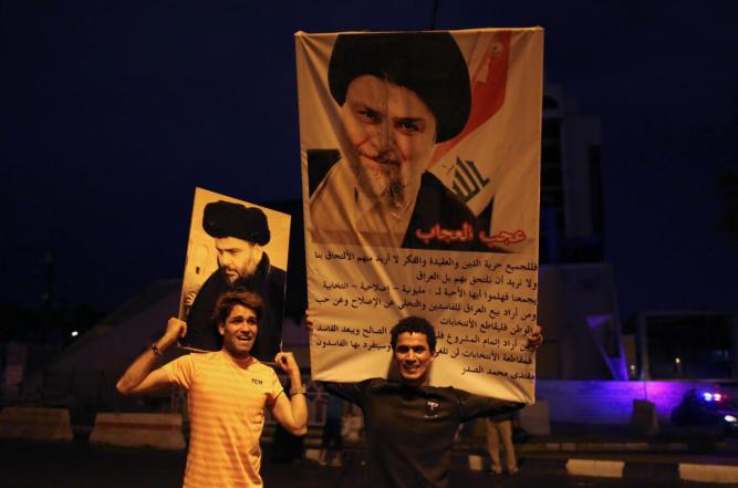 Iraqi supporters of Sairun list celebrate with portraits of Shi'ite cleric Moqtada al-Sadr, after results of Iraq's parliamentary election were announced in Baghdad