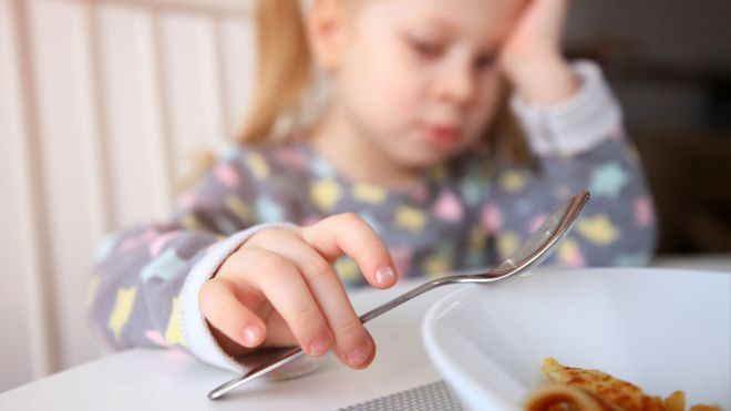 _102106778_child_eating_getty