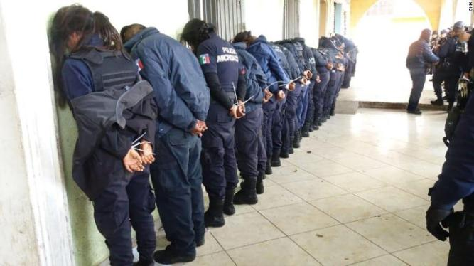 180625153631-01-mexico-police-force-detained-exlarge-169
