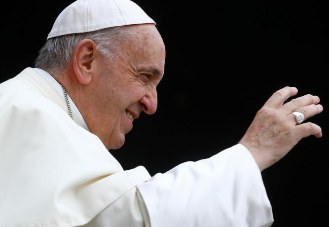 FILE PHOTO: Pope Francis arrives to lead the Wednesday general audience in Saint Peter's square at the Vatican