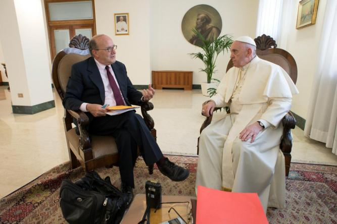 FILE PHOTO: Pope Francis listens to reporter question during an exclusive interview with Reuters at the Vatican