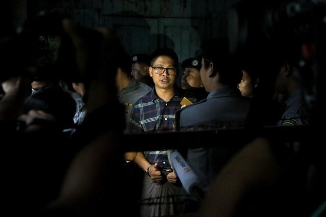 Detained Reuters journalist Wa Lone speaks to members of the media at the Insein court in Yangon
