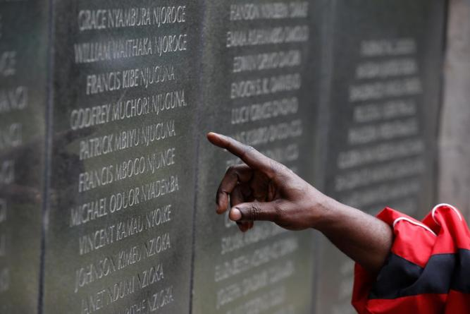 Ali Mwadama, a survivor of the 1998 U.S. Embassy bombing, looks for the names of his friends on the August 7th memorial in Nairobi