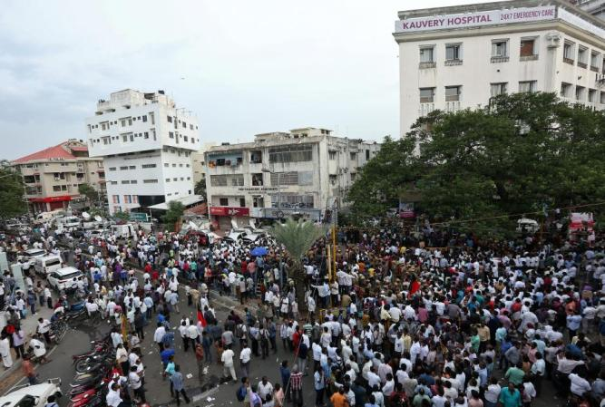 Supporters gather outside the hospital after the demise of Indian Tamil leader M. Karunanidhi, in Chennai
