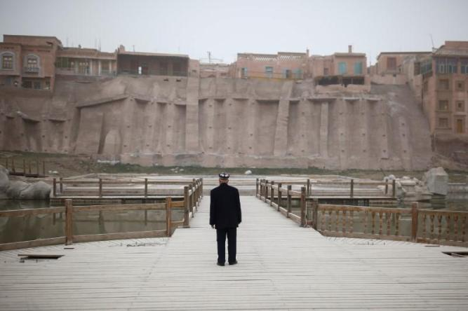 An ethnic Uighur looks at the old town in Kashgar