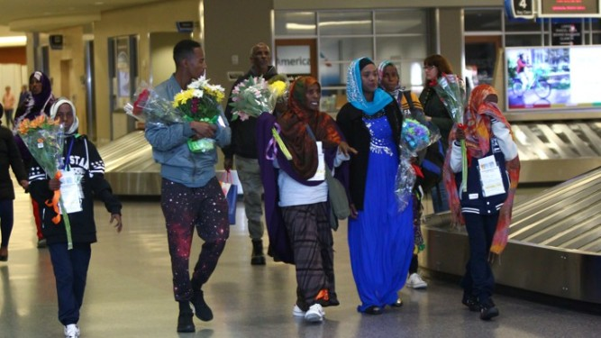 The family of Somane Liban, refugees from Somalia, walk through the Boise Airport after being met by their U.S.-based family members on arrival in Boise