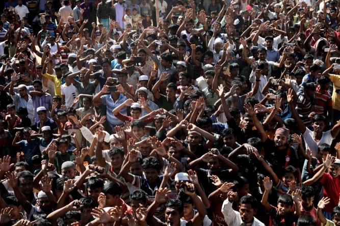 FILE PHOTO: Hundreds of Rohingya refugees shout slogans as they protest against their repatriation at the Unchiprang camp in Teknaf