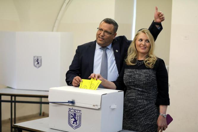 FILE PHOTO: Jerusalem mayoral candidate Moshe Lion and his wife cast their votes in the second round of local council elections in Jerusalem