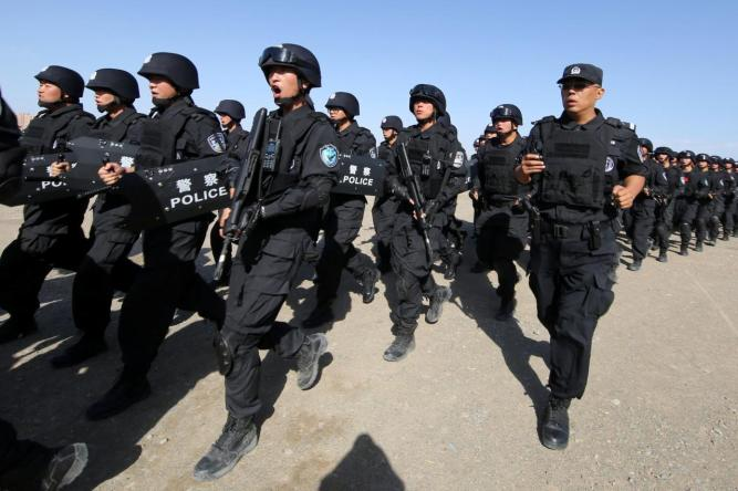 FILE PHOTO - Chinese soldiers participate in an anti-terror drill in Hami, Xinjiang Uighur Autonomous Region