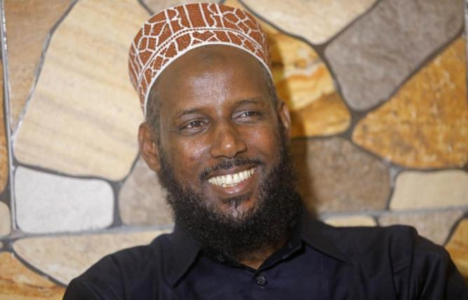 Former al Shabaab leader Mukhtar Robow attends a news conference in Baidoa