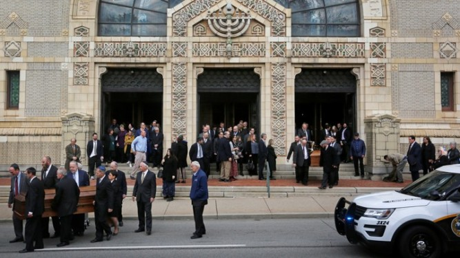 The caskets are carried from Rodef Shalom Temple after funeral services for brothers Cecil and David Rosenthal, victims of the Tree of Life Synagogue shooting, in Pittsburgh