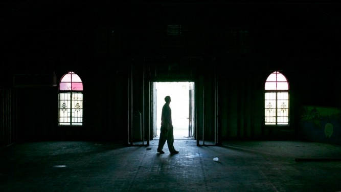 A man walks inside empty church at the Ninth Ward area in New Orleans