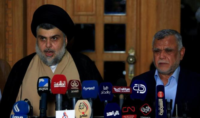 FILE PHOTO - Iraqi Shi'ite cleric Moqtada al-Sadr speaks during a news conference with Leader of the Conquest Coalition and the Iran-backed Shi'ite militia Badr Organisation Hadi al-Amiri, in Najaf
