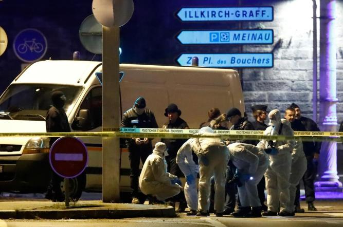Investigators work on the street during a police operation in the Meinau in Strasbourg