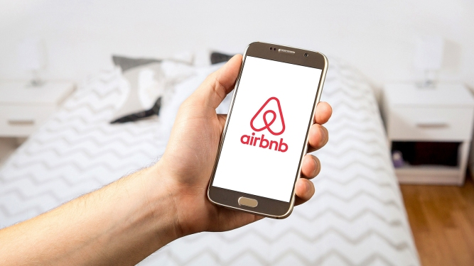 An Airbnb app loads on a phone. Photo courtesy of Pexels/Creative Commons