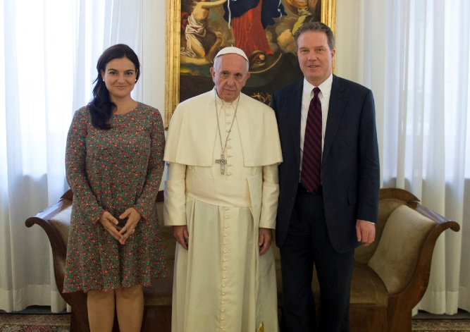 Pope Francis poses with Vatican spokesman Greg Burk and deputy Vatican spokesperson Paloma Garcia Ovejero during a meeting at the Vatican