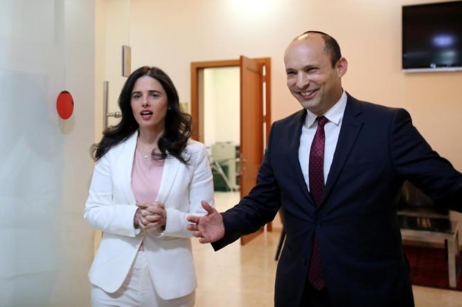 Israeli Education Minister Bennett and Justice Minister Shaked enter the room before delivering their statements in Tel Aviv