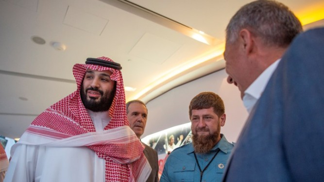 Saudi Crown Prince Mohammed bin Salman stands with Head of the Chechen Republic Ramzan Kadyrov during the Emirates Formula One Grand Prix at the Yas Marina racetrack in Abu Dhabi