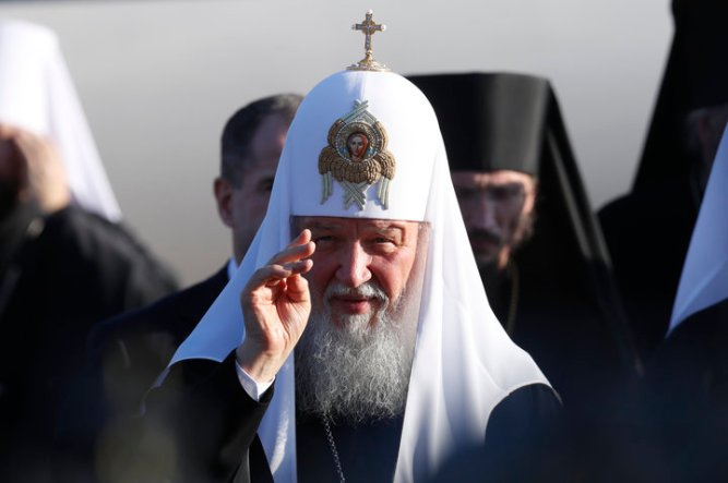 Russian Orthodox Patriarch Kirill attends a welcoming ceremony after arriving at Minsk National Airport