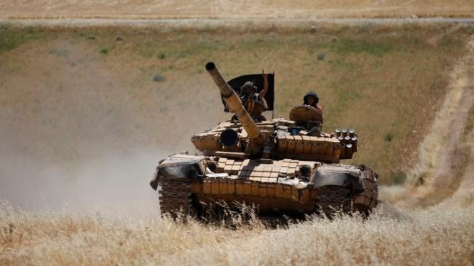 Islamist Syrian rebel group Jabhat al-Nusra drive a tank on Al-Khazan frontline