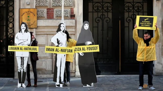 demonstrators-from-amnesty-international-protest-outside-the-saudi-arabian-embassy-on-international-women-s-day-in-paris-1