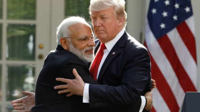 India's Prime Minister Modi hugs U.S. President Trump as they give joint statements in the Rose Garden of the White House in Washington