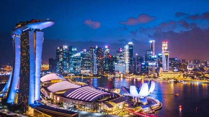 Aerial-view-of-Singapore-skyline-at-night-near-Marina-Bay-Singapore-_1116483092